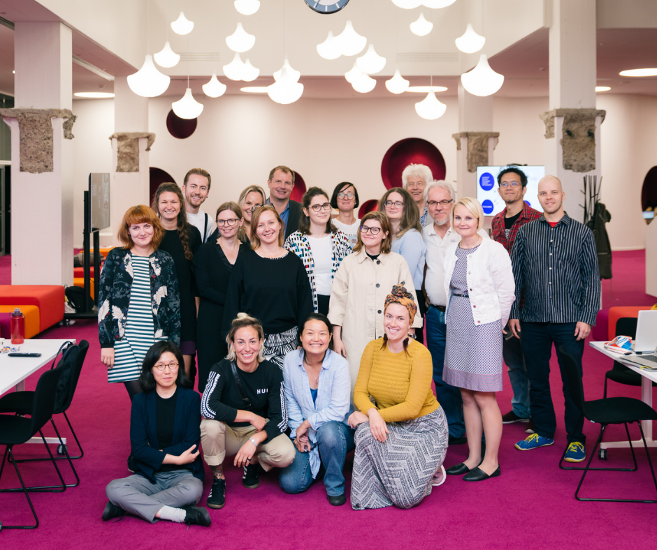 Group of students, teachers and partner in Aalto University Learning Center